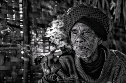 Iceland En Route - Myanmar Photo Workshop - Old man smoking a cheroot